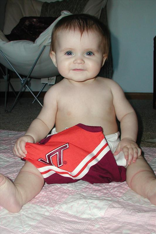 Look, my cousin Chris got me a new diaper! I think I'll wear it under my jayhawk outfit for the big game.