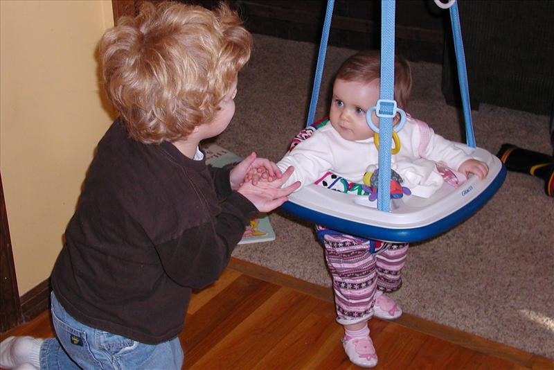 Callan teaching Molly to use the jumper