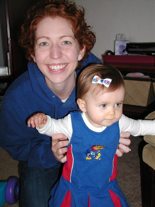Molly and Mommy cheering for KU