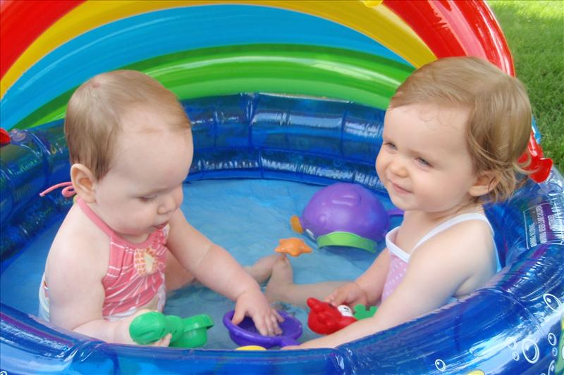 Avery and Molly playing in the pool
