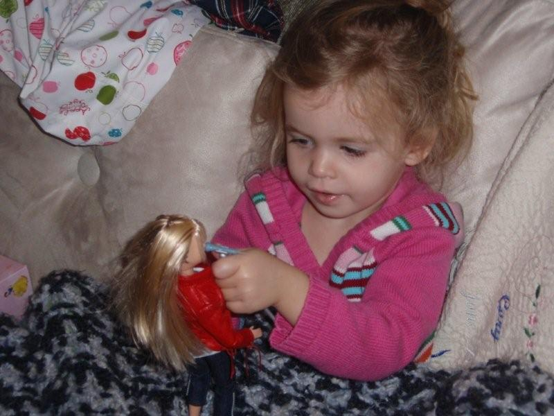 Molly helping her doll put on a concert :)