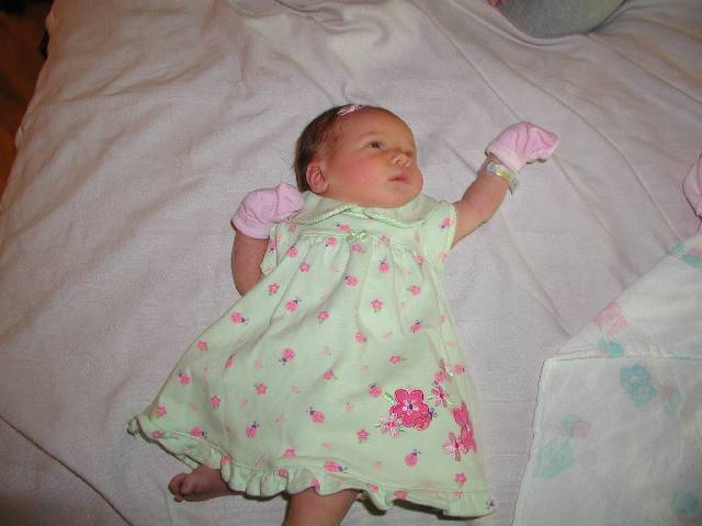Posing for the camera in a dress from Aunt Amber.