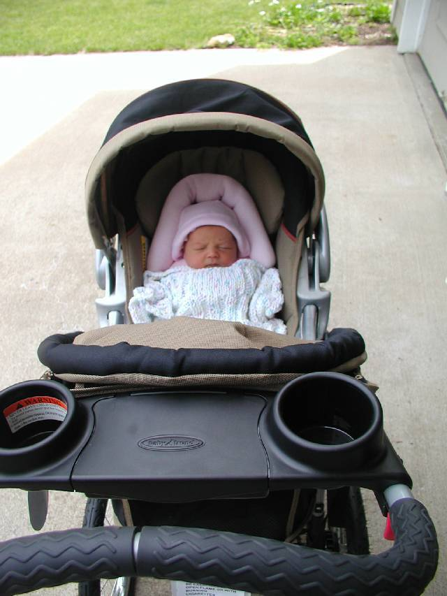 All set for the first walk in the stroller.
