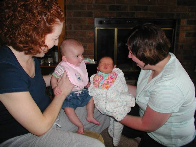 Molly meets Chloe for the first time, wait I thing the moms are holding the wrong babies :)